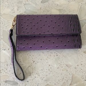 Purple leather small wristlet bag.